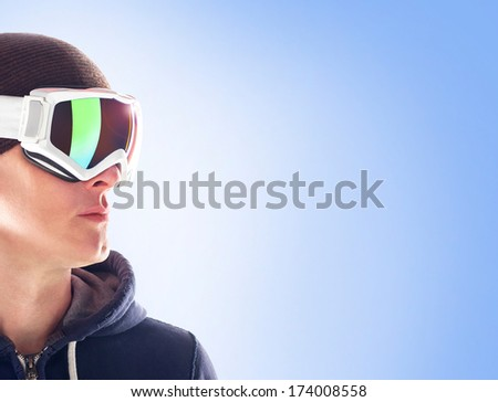 Man in ski goggles on blue background