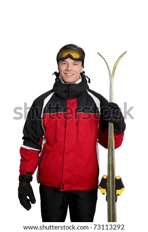 Man in ski outfit standing on white background - stock photo