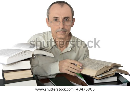 man in spectacles works with books and documents