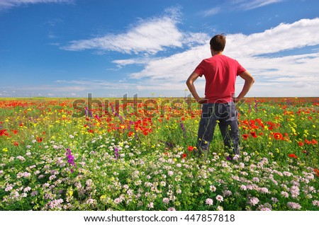 Man in spring meadow of flower. Conceptual scene. - stock photo