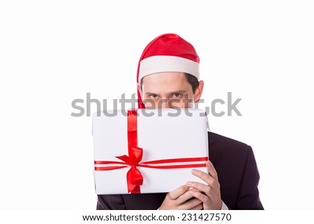 man in suit and hat with Christmas gift in hand on white background - stock photo