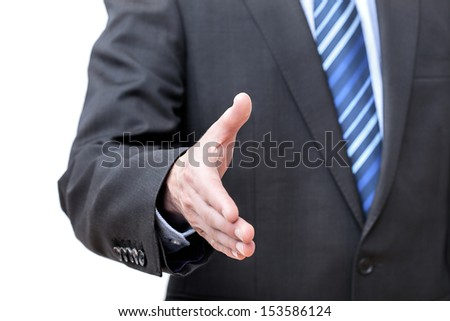 Man in suit giving hand for greeting, isolated - stock photo