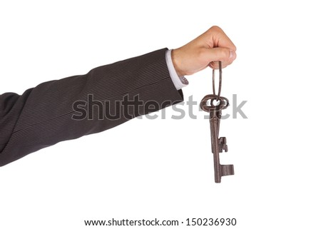 Man in suit giving old keys to a house, isolated on white