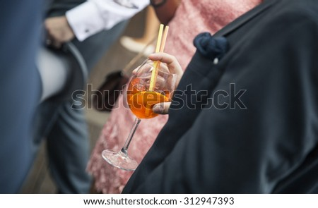 Man in suit holding a cocktail glass