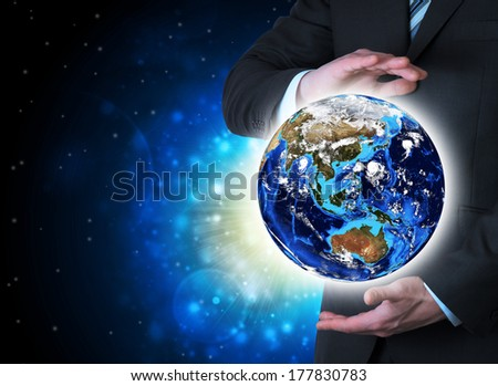 Man in suit holding a earth in hand. The concept of globalization