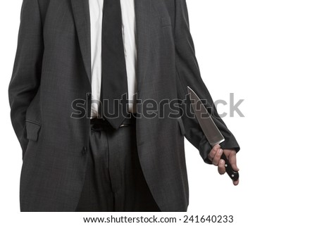 Man in suit holding a large knife in his hand isolated on white background