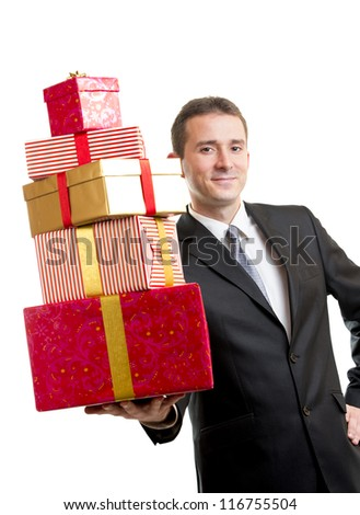 Man in suit holding a stack of presents - stock photo