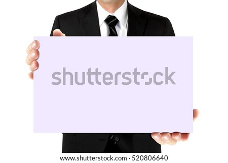 Man in suit holding blank card board