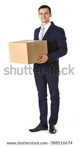 Man in suit holding carton boxes isolated on white background - stock photo