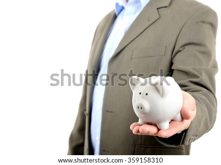 man in suit holding piggy bank isolated on white - stock photo