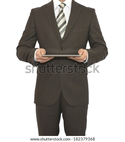Man in suit holding tablet pc. Crop