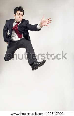 Man in suit jumping moving forward in struggle going ahead