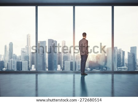 Man in suit looking at sunrise. 3d render