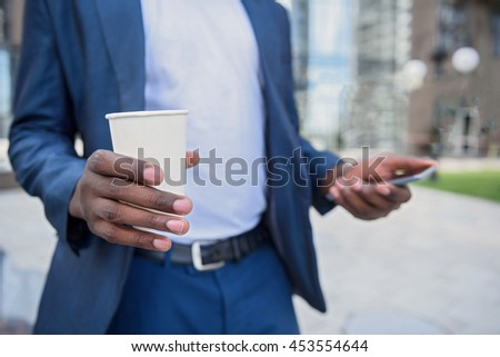 Man in suit making break after work - stock photo