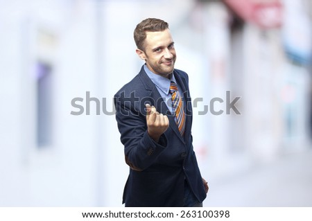 Man in suit Money gesture next to a cashier - stock photo