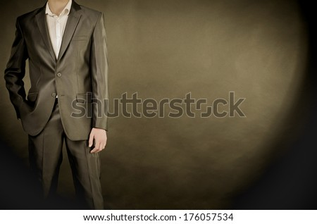 man in suit on a black background - stock photo
