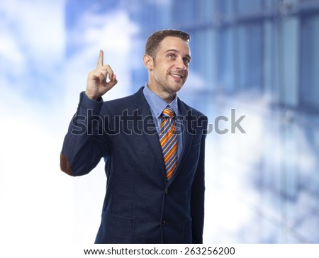 Man in suit pointing upwards having an idea - stock photo