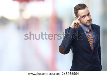 Man in suit self-confidence in front of an office - stock photo