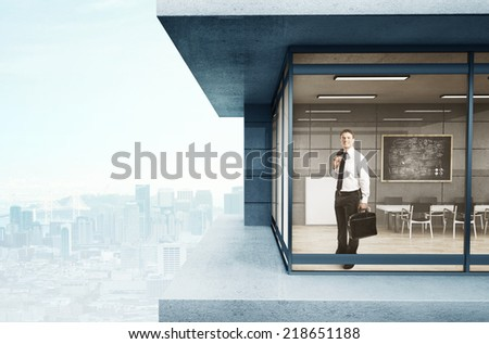 man in suit standing in loft house - stock photo