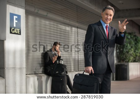 Man in suit traveling quickly and carrying light bag - stock photo
