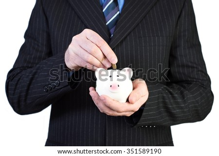 man in suit with a money box