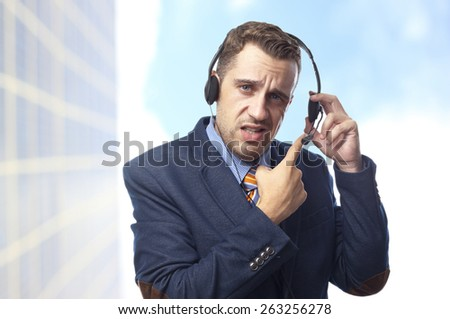 Man in suit with headphones and microphone