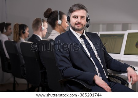 Man in suit with headset working in call center