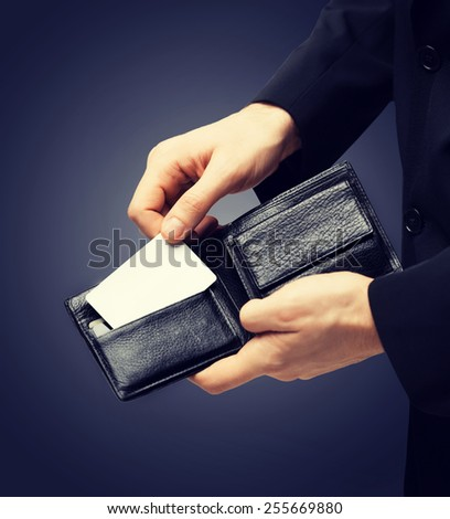 man in suit with wallet and credit card - stock photo