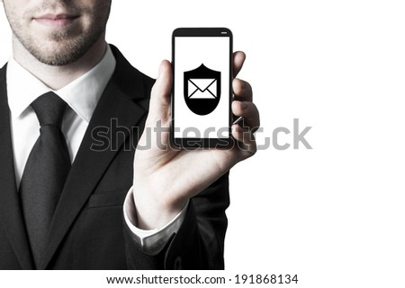 man in suite holding smartphone with security shield mail symbol - stock photo