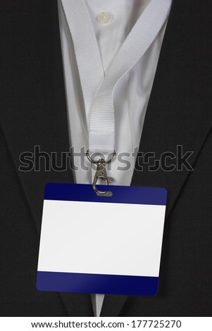 man in suite wearing a blank pass card arround his neck - stock photo
