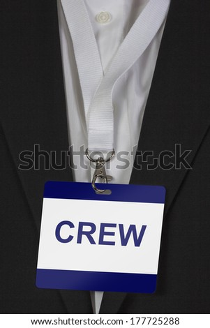 man in suite wearing a Creww pass arround his neck - stock photo