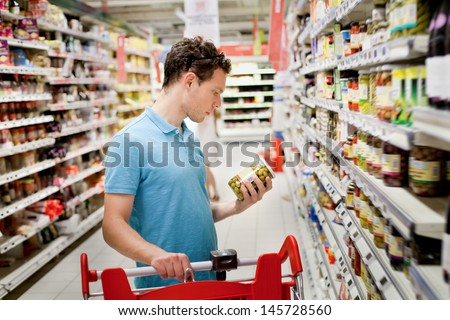 man in supermarket - stock photo