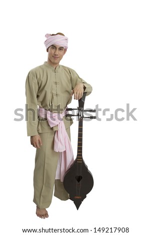 Man in Thai northern costume and ancient musical intrument  on white background
