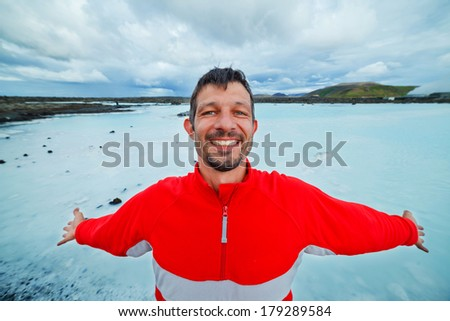 Man in The Blue Lagoon geothermal bath resort in Iceland - stock photo
