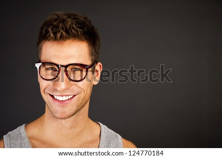 Man in the grey tank top shirt look at the camera - stock photo