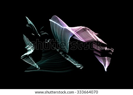 man in the LED tape makes movements of capoeira Capoeira is a Brazilian martial art - stock photo