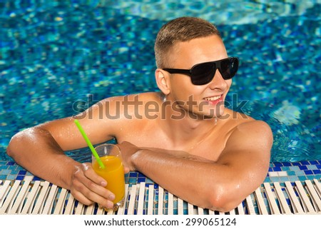 man in the pool - stock photo