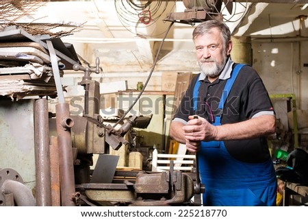 man in the production of a vise - stock photo