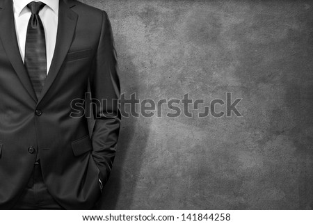 man in the suit on concrete background