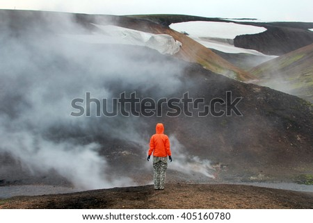 Man in the volcanic landscape. Iceland.