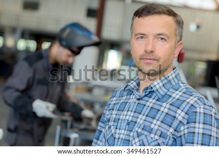 man in the welding shop