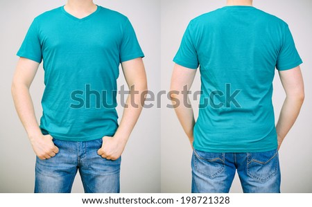Man in turquoise t-shirt. Grey background. - stock photo