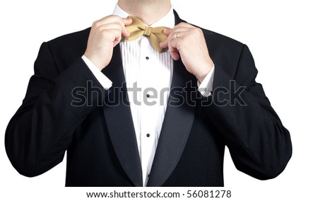 Man in tuxedo adjusting bow tie. Closeup. - stock photo