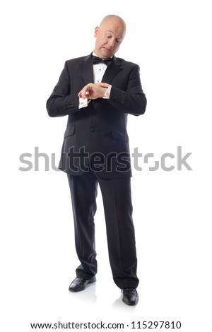 man in tuxedo late for something important - stock photo