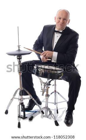 man in tuxedo playing drums isolated on white - stock photo