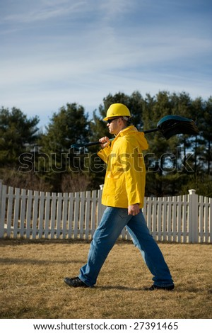 Man in uniform with a shovel - stock photo