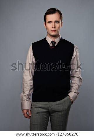 Man in vest isolated on grey background - stock photo