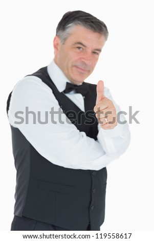 Man in waistcoat giving thumbs up