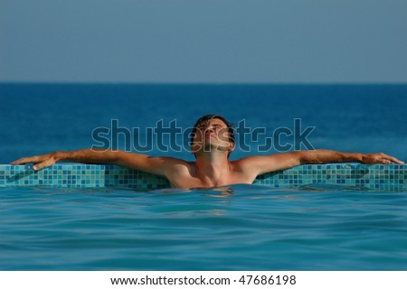 Man in water pool - stock photo