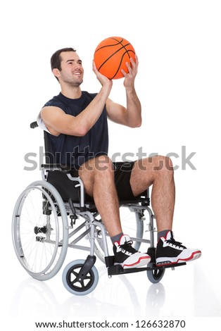 Man in wheelchair playing basketball. Isolated on white - stock photo